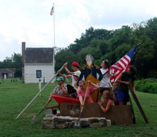 "ImageAnna posing with fellow interns, ""crossing the delaware"" on July 4th at Ferry Farm"